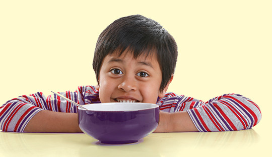image of child eating breakfast