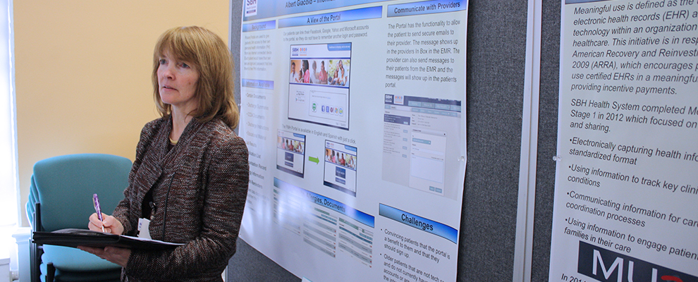 image of Ruth Cassidy reviewing research posters