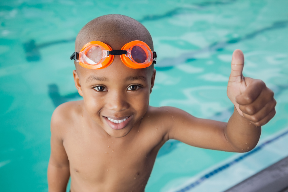 Image of little boy at pool avoiding summertime injuries