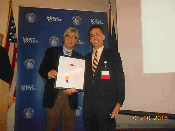 Image of Dr. James Croll, MD, accepting a recognition award