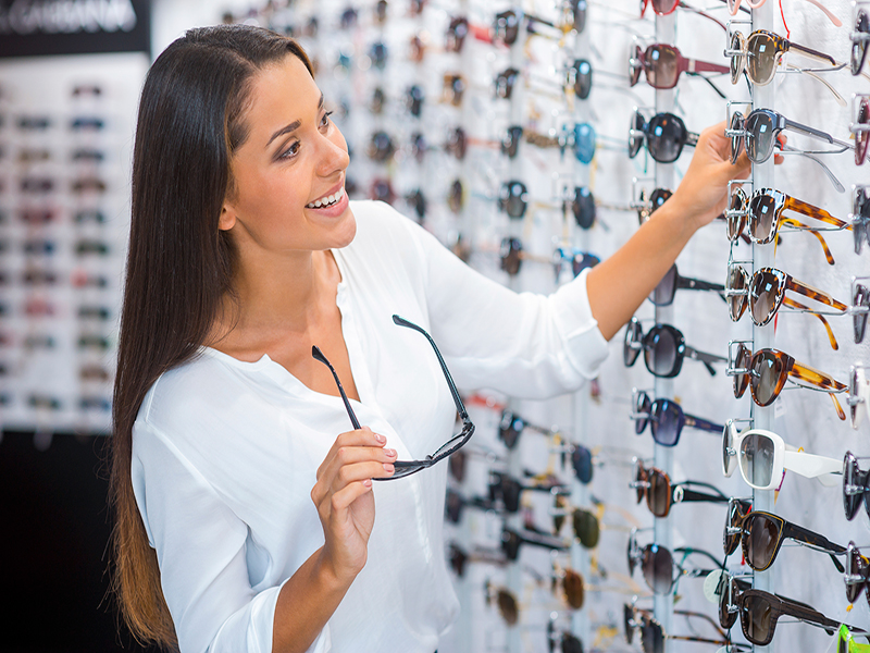 Image of woman choosing sunglasses