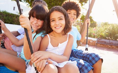 Image of children on swing