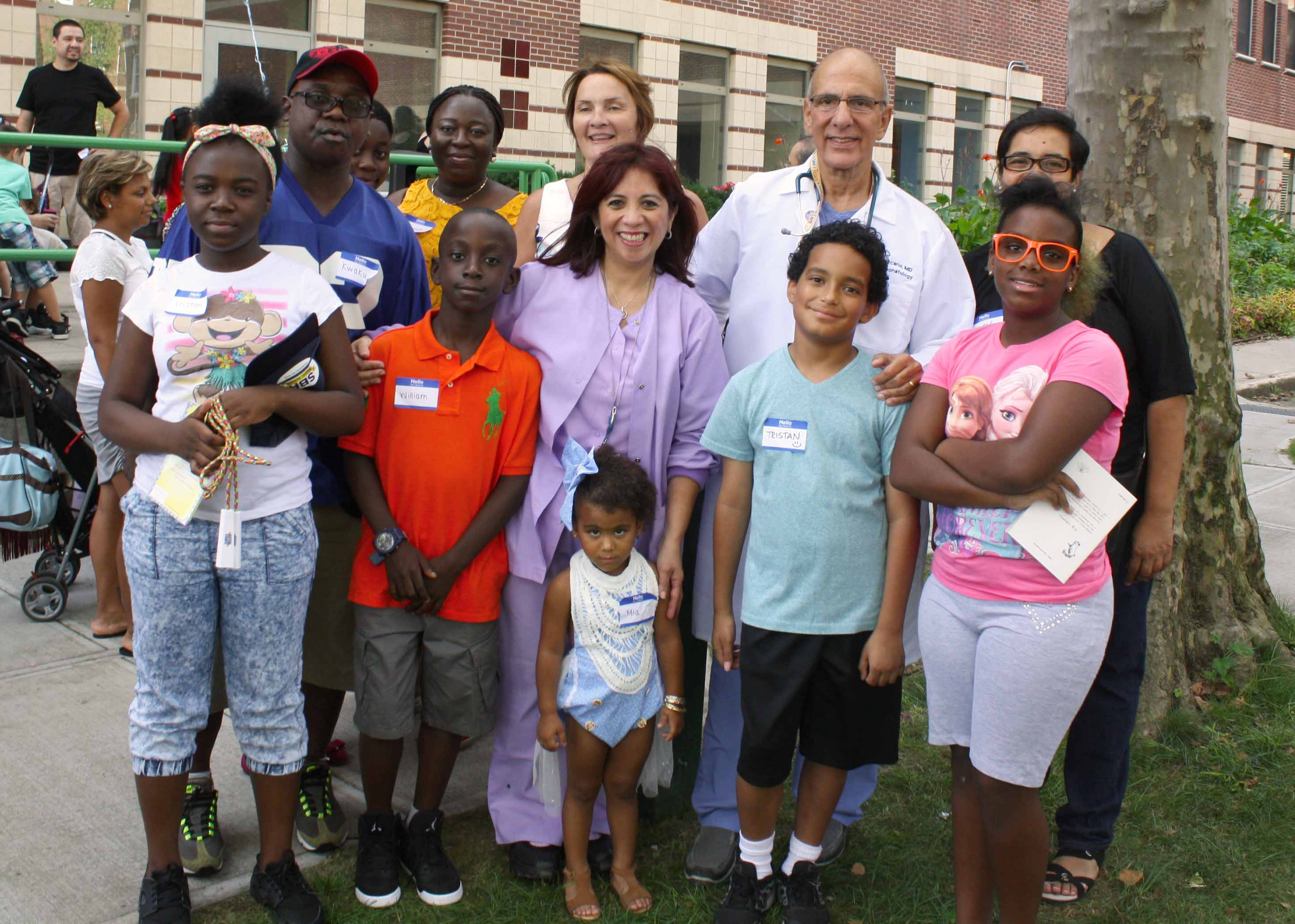 Image of Dr. Lezcano, parents and children at the SBH NICU Reunion