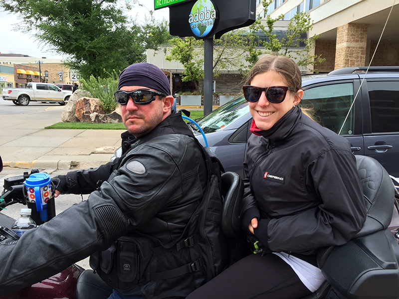 Image of Dr. Robert Karpinos and daugher on bike
