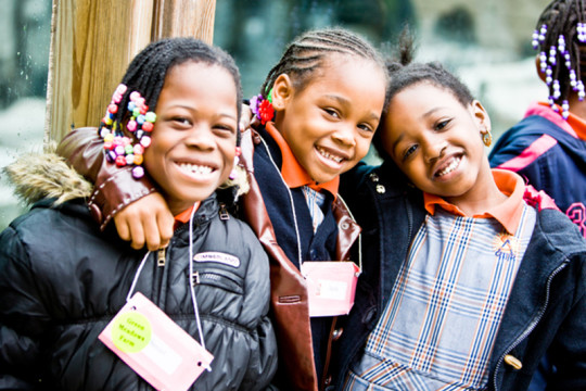 Image of three girls in the community