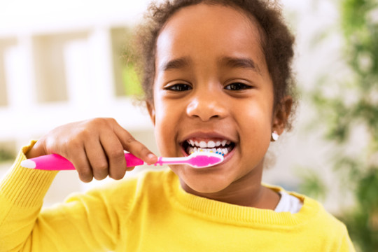 Image of child with a healthy smile