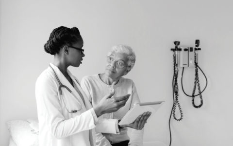 Image of female doctor consulting with patient