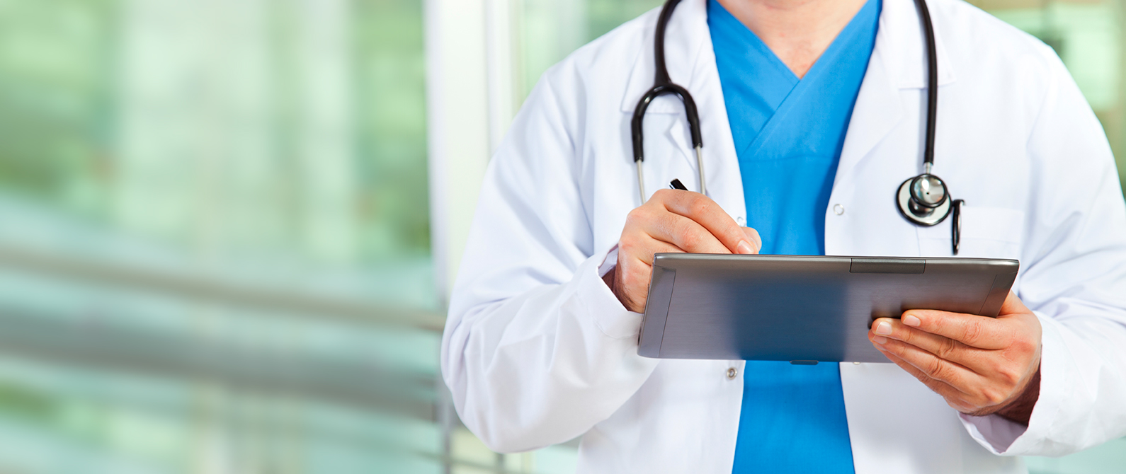 image of doctor holding tablet