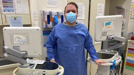 Jakub Bartnik, MD, SBH Emergency Medicine next to ultrasound devices