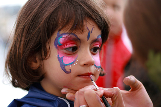 image of child with face paint enjoying springtime in the Bronx