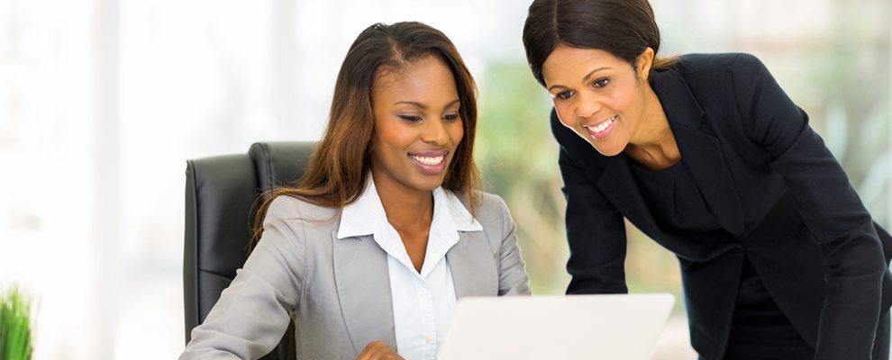 image of two business women at a desk