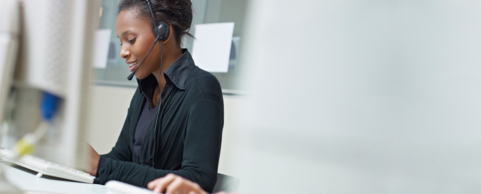 image of woman with headset scheduling an appointment