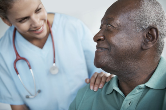 Image of a doctor talking to a patient to reduce hospital readmissions