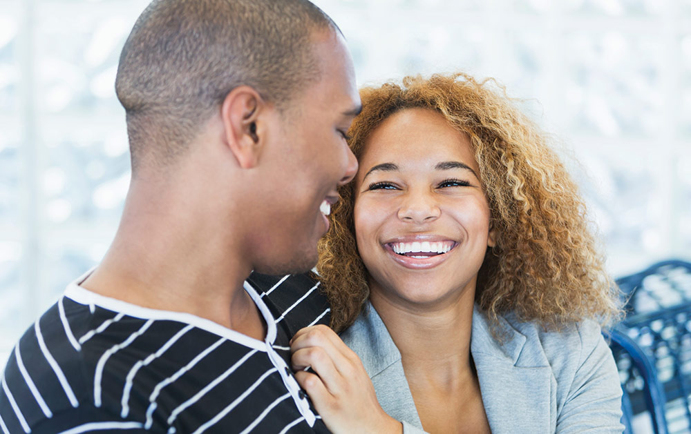 Image of couple smiling at each other