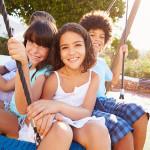 Image of children on swing enjoying the summertime