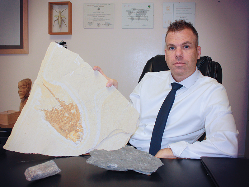 Image of Dr. Lazar, MD, with fossil