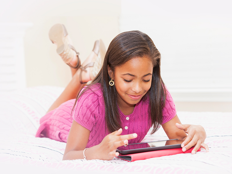 Image of girl using electronic tablet