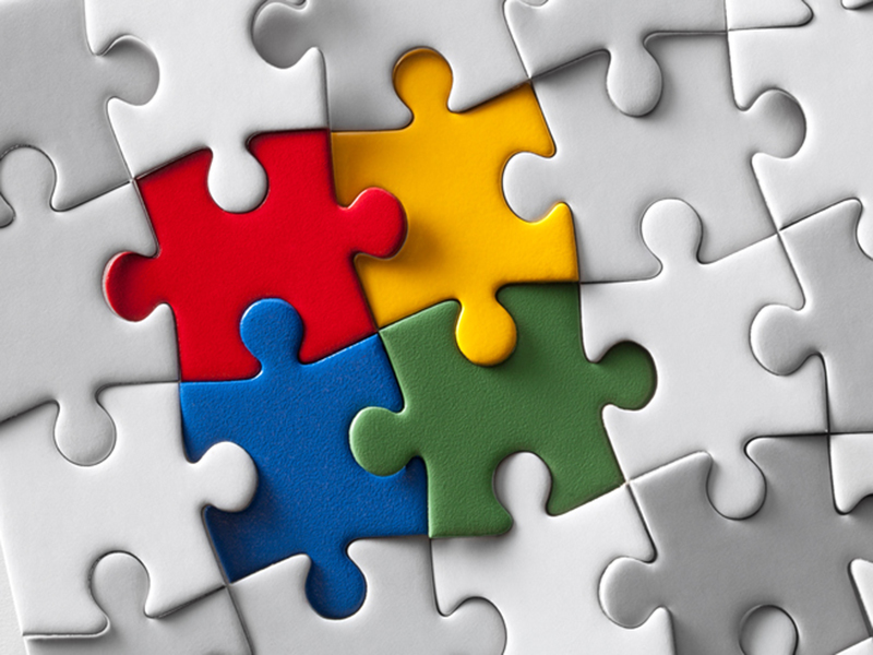 Image of puzzle pieces put together to represent the blend of mental health within primary care