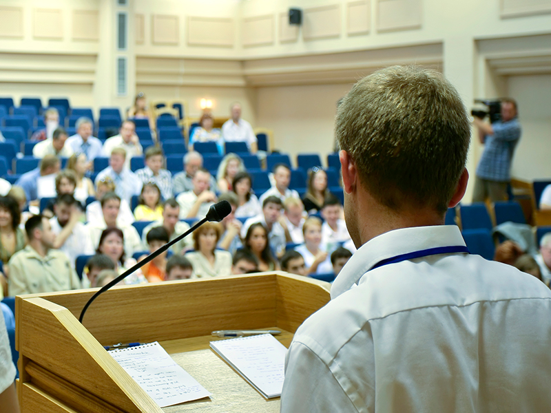Image of Doctor giving lecture in auditorium